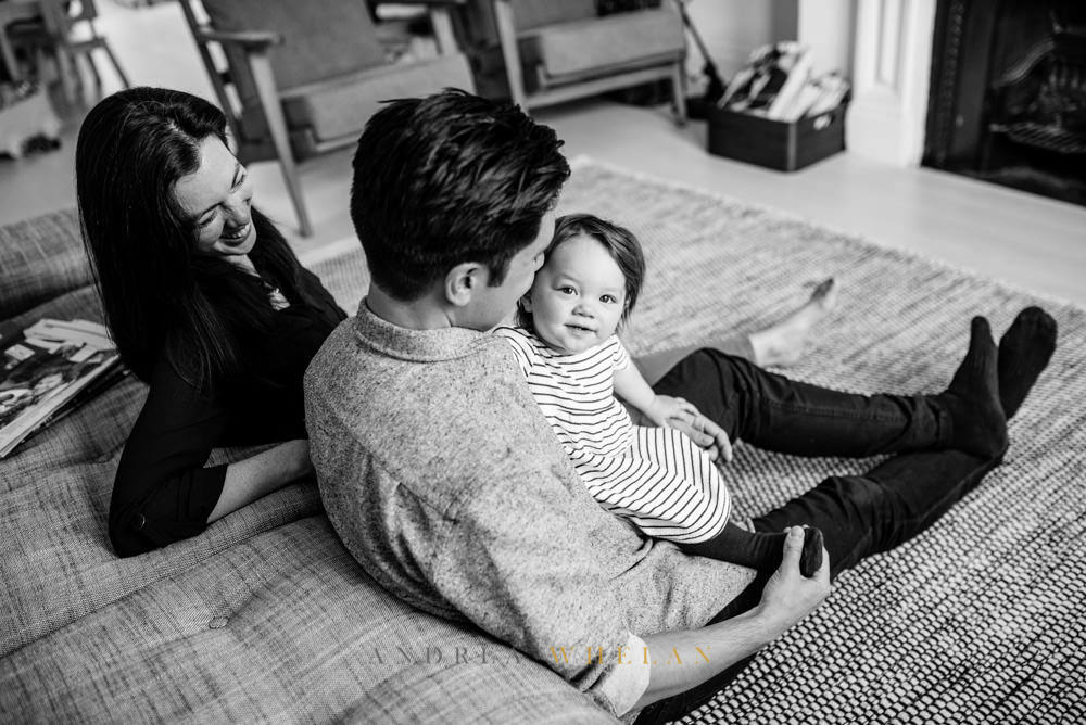 black and white family portrait in London home