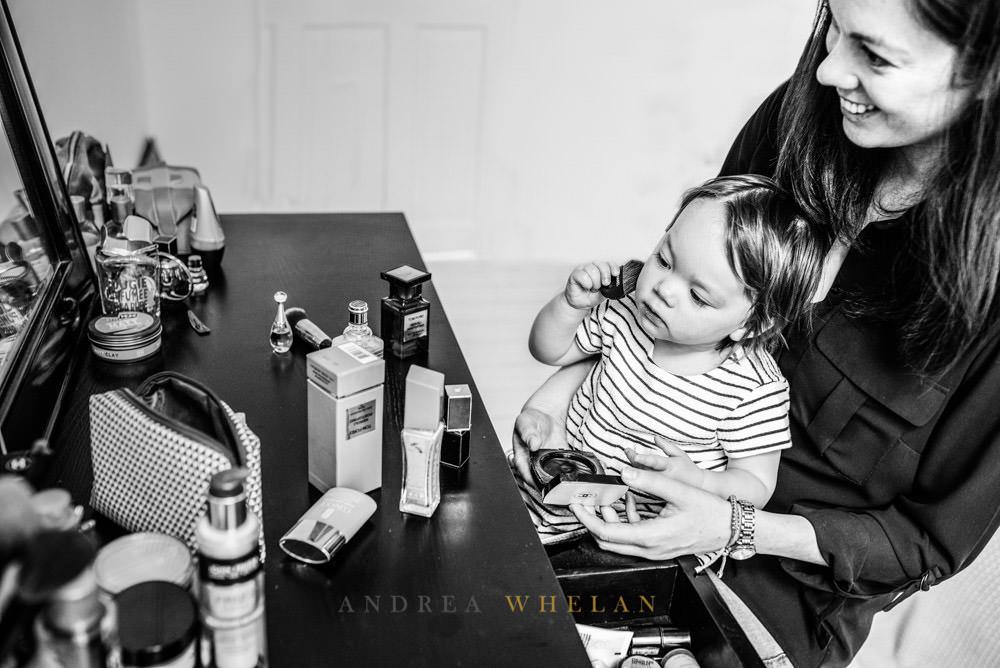 Little girl applying mothers make-up