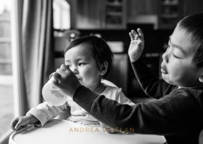 brother feeding sister