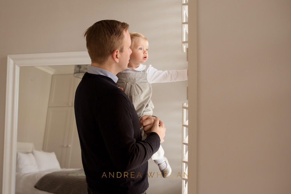 father and daughter looking out of window